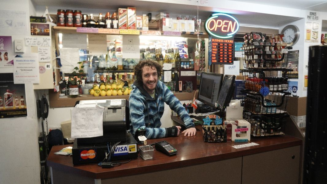 Friendly staff at Banff International Hostel liquor store